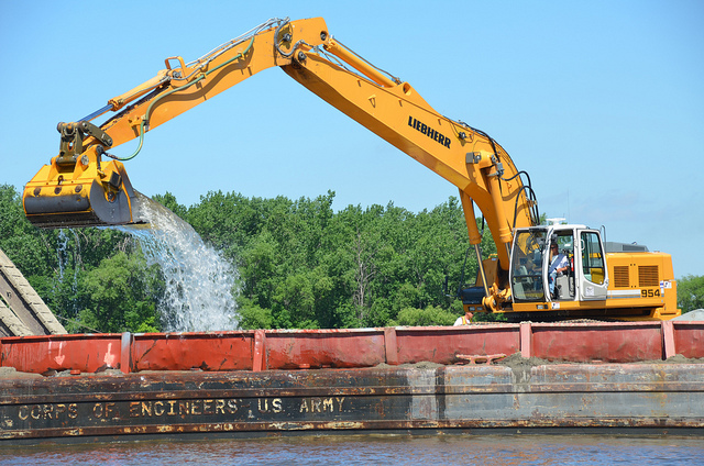 Dredging can cause turbidity levels to spike in a river as sediment is stirred up. Photo Credit: USACE St Paul District, via Flickr.