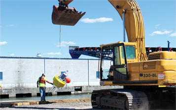 Deploying a data buoy at a dredging site.