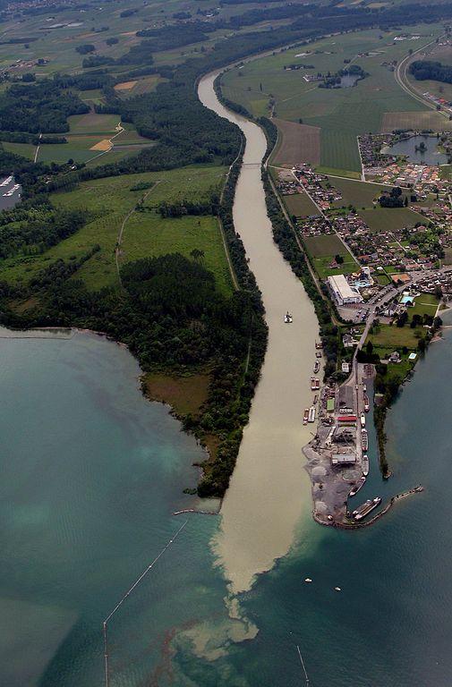 Sediment transported down the Rhone River into Lake Geneva can be detrimental to the lake quality. (Photo Credit: Rama, 2007, via Wikimedia)