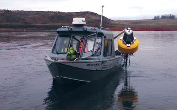 Deploying a data buoy.