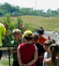 """Jeff Robichaud, deputy director of EPA Region 7's environmental services division visits with youth at an event announcing an expansion of water-quality monitoring of Kansas City area streams and introduction of a new App """"KCWaterBug"""""""