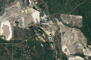 Satellite images show the growth of pit mines over Canada's oil sands as of 2011 (Credit: NASA/Goddard Space Flight Center)