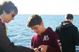 Rogers City middle school students gather data in Lake Huron near the mouth of the Trout River