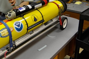 An ocean-going glider equipped with a digital acoustic monitoring instrument (Credit Nick Woods/Woods Hole Oceanographic Institution)