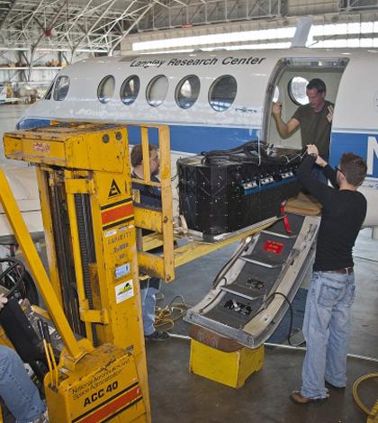 NASA workers prepare research airplane (Credit: NASA Langley/Sean Smith)