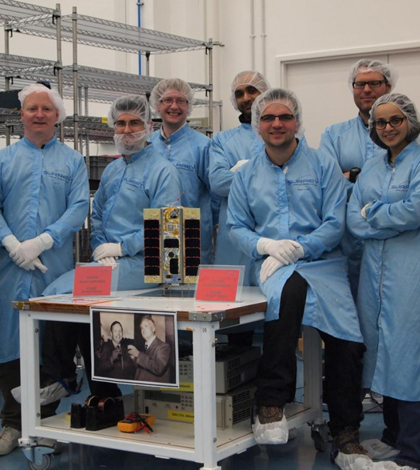 The Surrey Satellite team and the smartphone satellite (Credit: Surrey Satellite Technology)