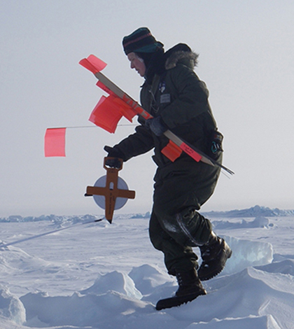 UD's Cathleen Geiger measures sea ice. (Credit: University of Delaware)