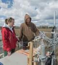Jack Puleo and graduate student Aline Pieterse conduct research in the Brockonbridge Marsh. (Credit: University of Delaware)