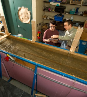 Geology Assistant Professor Chris Lowry and PhD student Ethan Mamer in Natural Sciences Complex lab