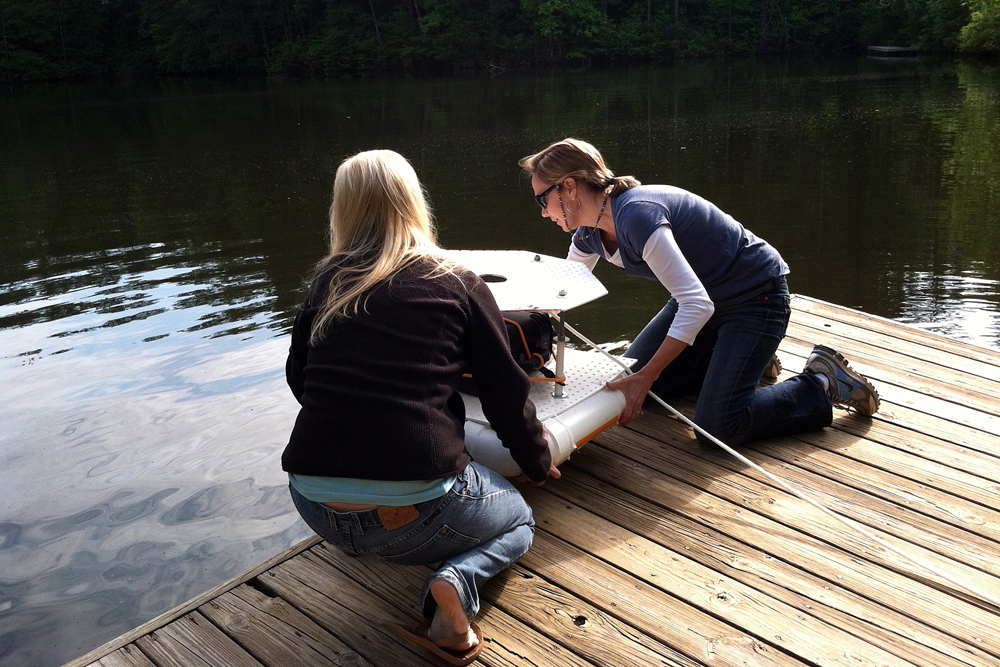 Lisa Adams and student Chelsea Kuykendall work on a buoy near beaver pond at the Chattahoochee Nature Center (Credit: Michael Dias)