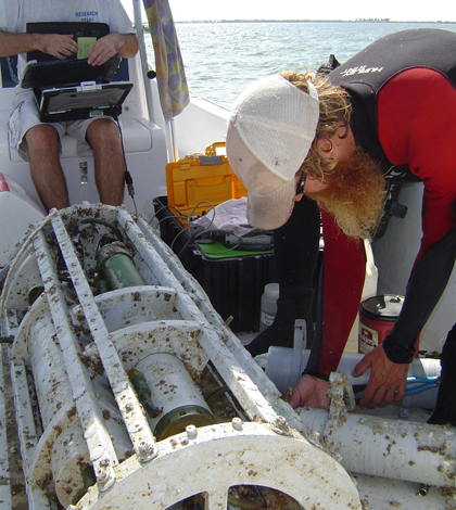 Scientists with the Sanibel-Captiva Conservation Foundation perform monthly service updates on a LOBO sensor package (Credit: SCCF)