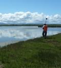 A USGS researcher surveying San Francisco Bay marsh topography using a RTK GPS measuring unit (Credit: Kevin Buffington/USGS)