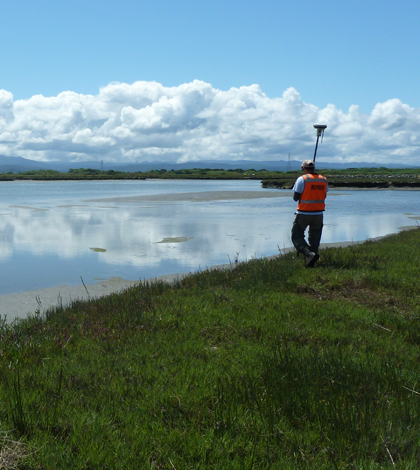 A USGS researcher surveying San Francisco Bay marsh topography using a RTK GPS measuring unit (Credit: Kevin Buffington/USGS)