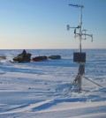 Snowmobile expedition checks on a weather station in the USGS polar Alaska climate and permafrost monitoring network (Credit: Frank Urban)