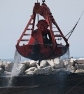 A clamshell dredge in action (Credit: U.S. Army Corps of Engineers)