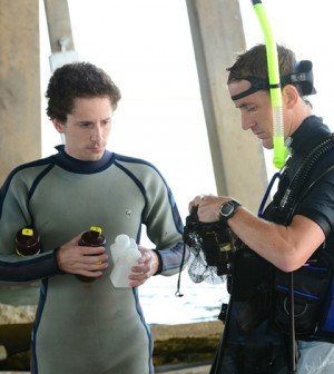 A Harte Research Institute collect water samples for a comprehensive study of Oso Bay (Credit: Texas A&M University Corpus Christi)