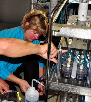 WHOI microbial ecologist Virginia Edgcomb, seen here working on a deep-sea robotic incubator (Credit: Cherie Winner, Woods Hole Oceanographic Institution)