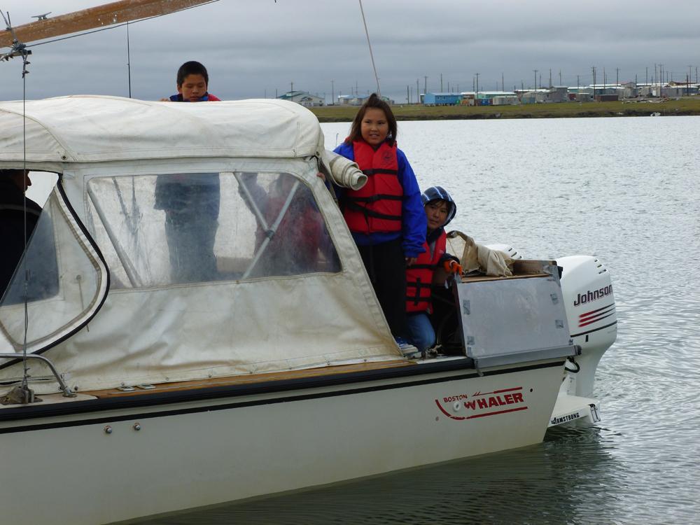 Kaktovik students prepare for a trip aboard Camp ANWR's Boston Whaler (Credit: Carla Stanley)