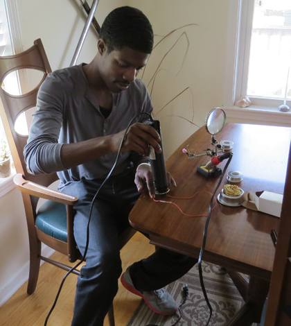 Kersey Sturdivant works with the components of a small CTD (Credit: Andrew Thaler)