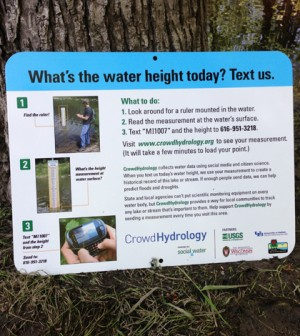 Signs at CrowdHydrology gauges instruct passersby to text water level data (Credit: Chris Lowry)
