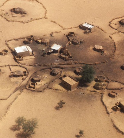 Image: A deserted village in Africa (Credit: John Isaac, UN Photo)