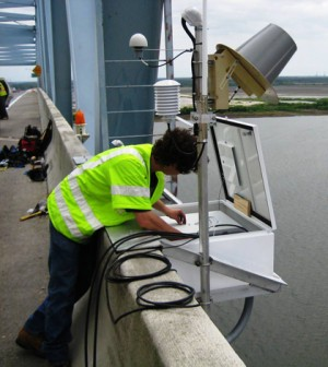 A CO-OPS employee installs an air gap sensor which measures bridge clearance on the Don Holt Bridge in for the NOAA PORTS system inCharleston, S.C. (Credit: NOAA)