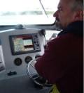 Donald Uzarski at the helm of the RV Chippewa