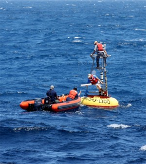 A crew works on the ocen mooring where the temperature sensors were deployed (Credit: Oregon State University)