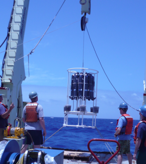 WHOI researchers lower a trace metal rosette (Credit: Emily Nahas, University of Washington)