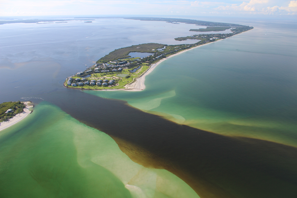 A dark band of CDOM-stained water from Lake Okeechobee is visible flowing through the Caloosahatchee Estuary (Credit: Sanibel-Captiva Conservation Foundation)