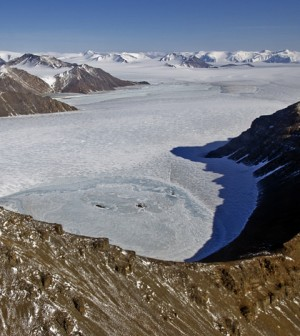 Glaciers flowing through a valley in northeast Greenland seen from NASA's P-3B research aircraft on Apr. 19, 2013. (Credit: NASA/Michael Studinger)