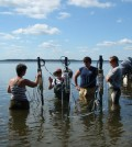 A Research team including Anderson takes field measurements on the New River Estuary (Credit: NOAA)