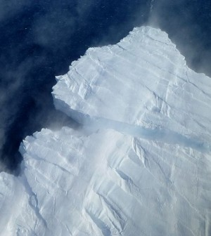 A nascent iceberg breaks off Pine Island Glacier's calving front. (Credit: NASA)