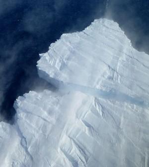 A nascent iceberg breaks off Pine Island Glacier's calving front. (Credit: NASA)