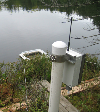 The wetland observatory's in-lake evaporation pan and its on-shore microprocessor radio device