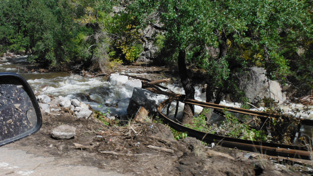 The flood pulled this guardrail out of the ground and strung it across Boulder Creek (Credit: Clayton Jensen)