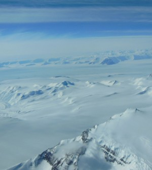 A view of Antarctica's ice sheet and mountains seen from a U.S. Air National Guard LC-130 aircraft during a flight to the South Pole in December 2012. (Credit: NASA/Christy Hansen)