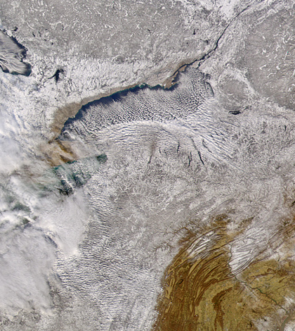 Cloud bands blow off of Lake Ontario, carrying lake effect snow over New York in 2004 (Credit: SeaWiFS Project, NASA/Goddard Space Flight Center, and ORBIMAGE)