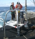 Justin Brodersen and Kim Page-Albins (OSU) in 2009 with instrument mooring before deployment 5 miles offshore of Yachats, Ore. (Credit: Oregon State University)