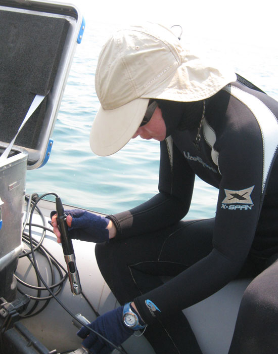 Wright State Ph.D. student Brianne Kelly taking oxygen measurements at Lake Tanganyika (Credit: Wright State University)