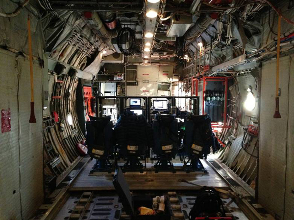 Interior of the plane showing the science station. The racks contain all computer and other equipment to control and monitor the two LVISs (Credit: The LVIS team)