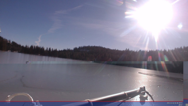 A sunset over a frozen mountain lake in the Sierra Nevadas from a SWIMS onboard camera (Credit: Ice911/ Satish Chetty)