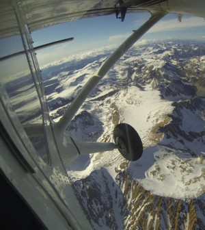 The view from a Twin Otter aircraft carrying NASA's Airborne Snow Observatory on April 3, 2013, as it flies over Mt. Dana and Dana Plateau in the Tuolumne River Basin within Yosemite National Park, Calif. (Credit: NASA/JPL-Caltech)