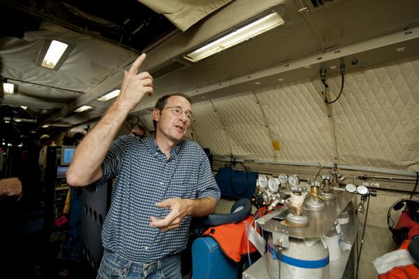 DISCOVER-AQ Principal Investigator James Crawford onboard NASA's P-3B aircraft (Credit: NASA/Paul E. Alers)