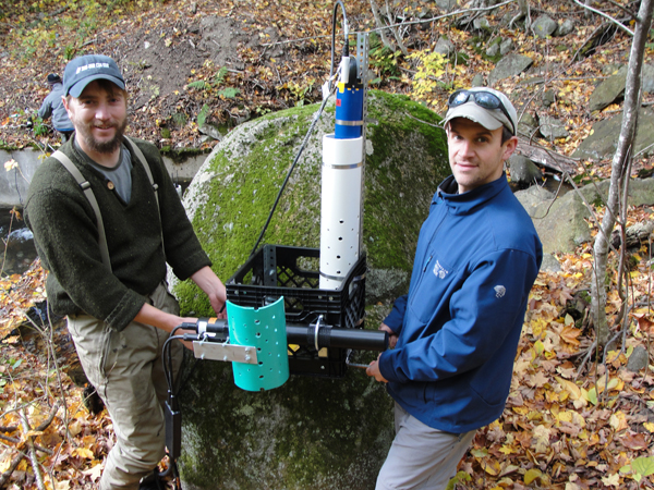 Adam Baumann and Lisle Snyder from the UNH Water Resources Research Center tend a sensor station (Credit: Jody Potter)