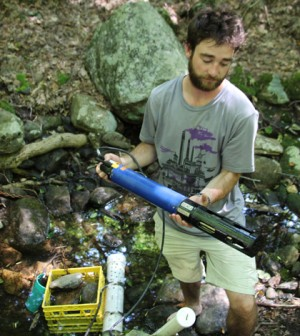 UNH's Water Resources Research Center lab technician Chris Cook checks aquatic sensor for debris. (Credit: Evelyn Jones)