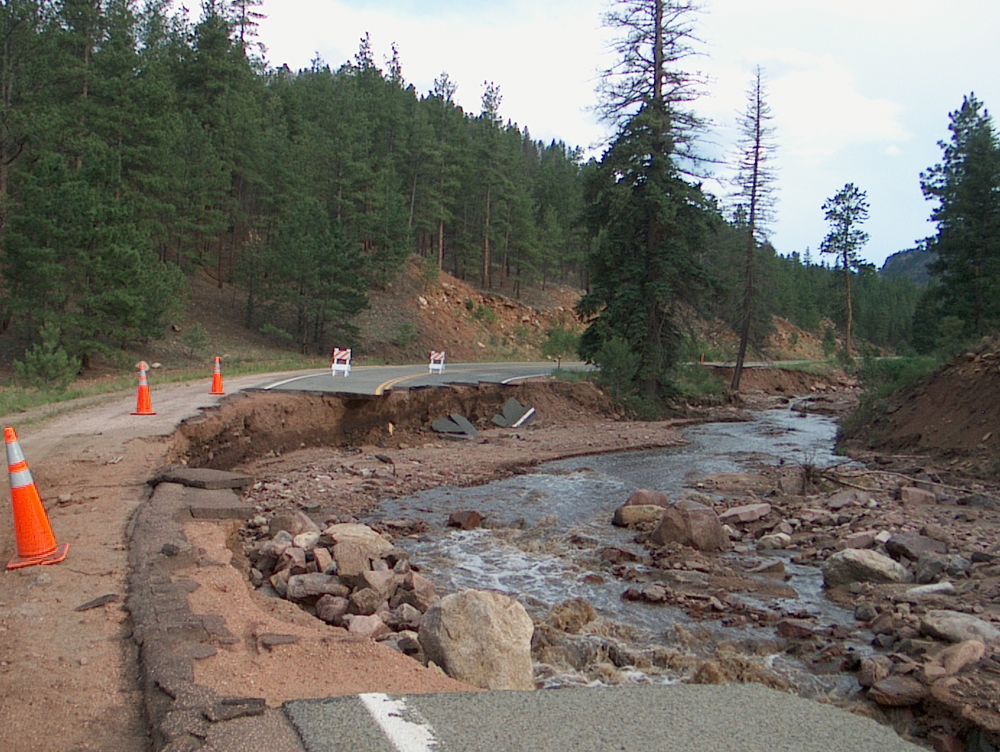 A 2006 flood spurred by runoff from the Hayman area caused millions in damage to a local highway (Credit: Michael Stevens/USGS)