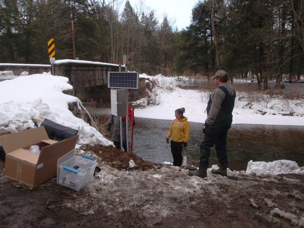 Working on a remote water quality monitoring station (Credit: Susquehanna River Basin Commission)