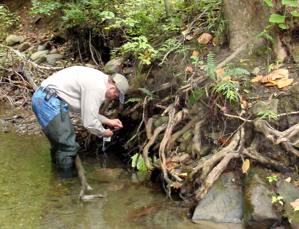 Installing temperature sensors that will help show whether the stream is suitable for Ohio brook trout (Credit: Cleveland Metroparks)