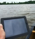 An iPad and GIS application in use while sampling on a Carver County lake (Credit: Charlie Sawdey)
